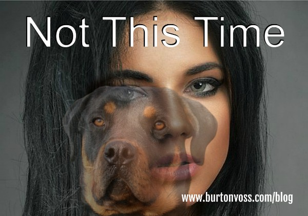 Close-up of a girl's face with a slightly offset, faded picture of a Rottweiler superimposed.